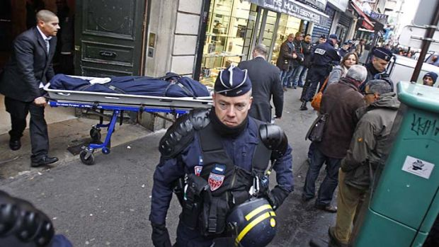 One of the three bodies of the killed Kurdish women is taken out of the building in Paris.