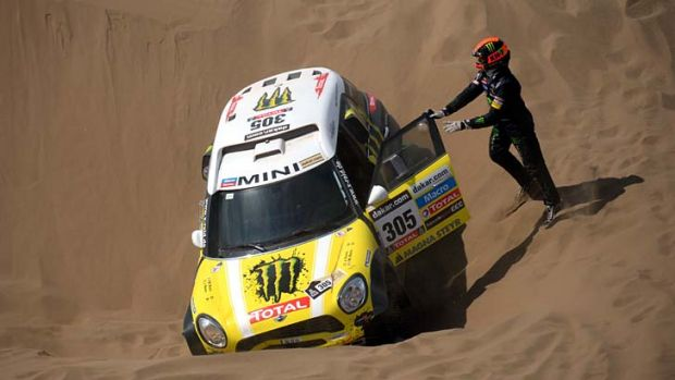 Mini's driver Nani Joan Roma of Spain is stuck in the sand during the Stage 6 of the Dakar 2013 between Arica and ...