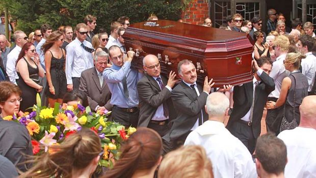 David Cassai's coffin is carried out of the church.