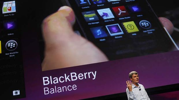 Research In Motion CEO Thorsten Heins shows off the BlackBerry Balance.