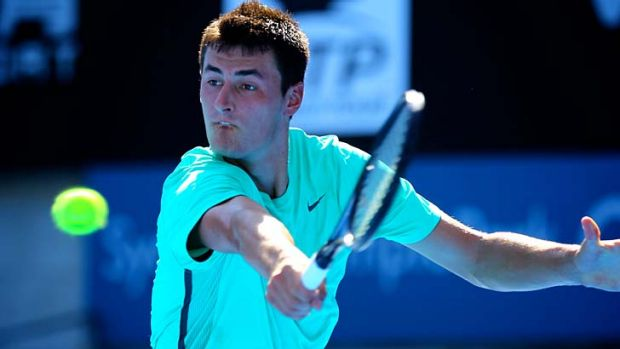 Young man in a hurry … Tomic in action on Friday.