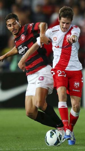 The accountant … Adam D'Apuzzo gets to grips with Melbourne Heart's Mate Dugandzic.