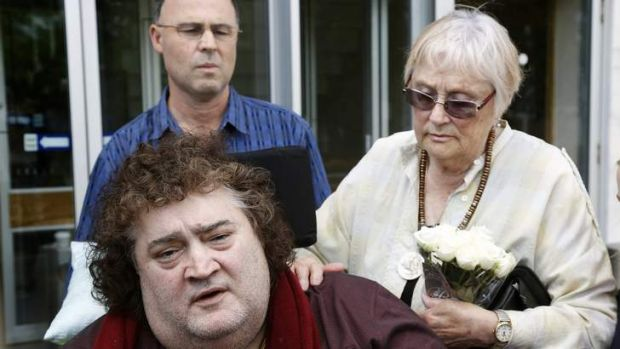Jonathan Crowley, front, with his mother Paloma and brother Paul after the appeal decision in the ACT Supreme Court.