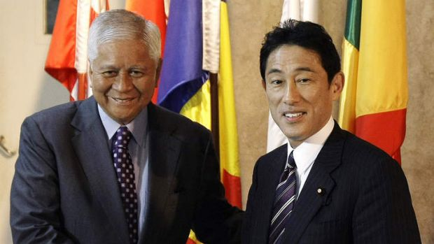 Philippine Foreign Affairs Secretary Albert del Rosario, left, poses with his Japanese counterpart Fumio Kishida for ...