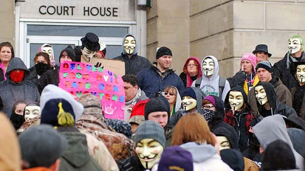 Anonymous protesters outside court.