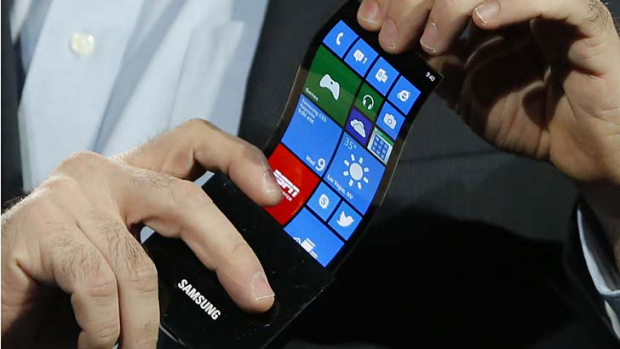 Bendable ... furture phones and tablets. Above, a Samsung prototype which can bend into a tube.