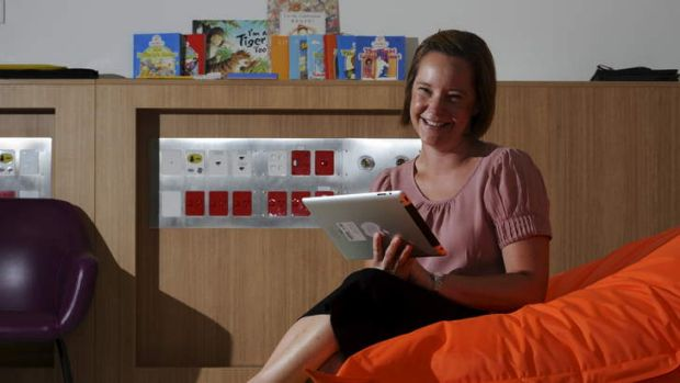 Assistant Director of Paediatrics at The Canberra Hospital, Katie McKenzie, reads her favourite books on her iPad.
