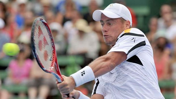 Locked and loaded … Lleyton Hewitt makes a backhand return on his way to a confidence-boosting victory.