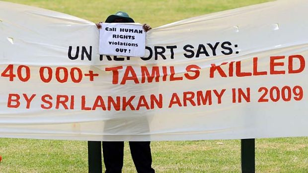 Activist ... a sign outside the MCG on Friday.