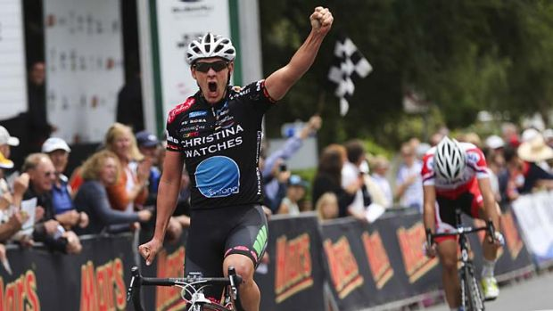 Winner … Jordan Kerby celebrates victory in the under-23 men's road race at the national titles at Mt Buninyong ...