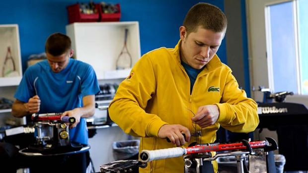 At work ... stringer Vasiliy Guryanov threads tennis racquets for players.