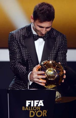 Lionel Messi with his fourth Ballon d'Or award.