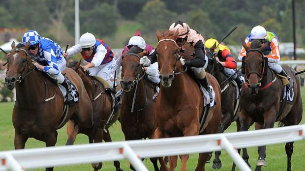 Glenn Boss (right) rides British General to victory in the Chester Manifold Stakes at Flemington on Saturday.