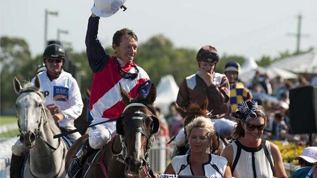 Pure magic … jockey Michael Cahill salutes the crowd after winning the Magic Millions Classic on the Gold Coast on ...