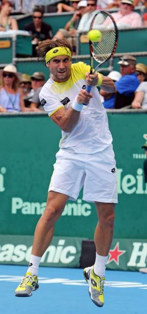 David Ferrer hits a return to Philipp Kohlschreiber of Germany during the men's singles final in Auckland on Saturday.