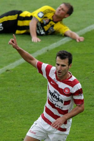 All over ... Labinot Haliti celebrates after scoring the clincher in the Wanderers' 2-0 victory in Wellington.