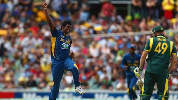Thisara Perera of Sri Lanka celebrates taking the wicket of Steven Smith during the One Day International in Adelaide.