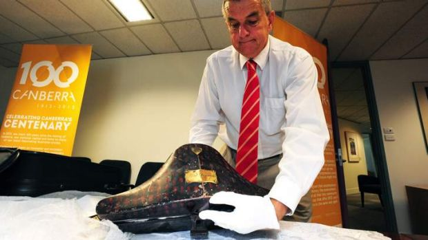 Dr David Headon unveils a hot box for the cocked hat with plumes worn by Lord Denman.