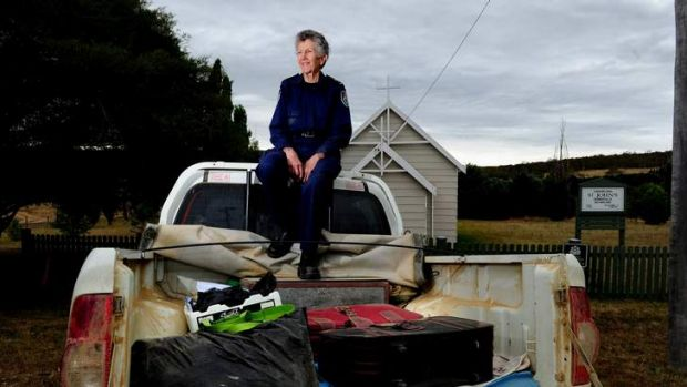 RFS and Ambulance Chaplain Jenni Roberts sits on the back of her ute with the items that she had decided to take with ...