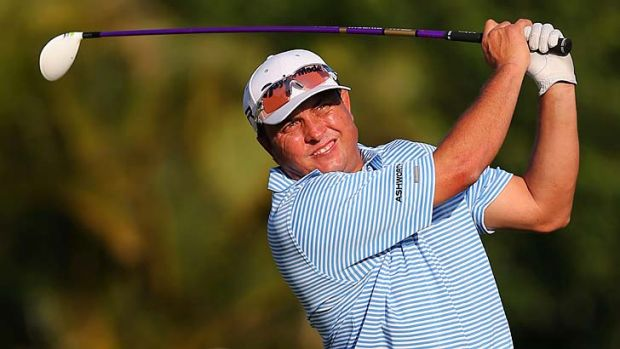 Scott Gardiner hits a tee shot on the 16th hole during the third round of the Sony Open in Hawaii.
