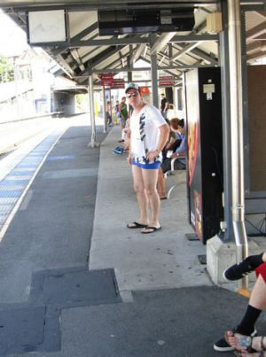 Beating the heat ... commuters go pants free.