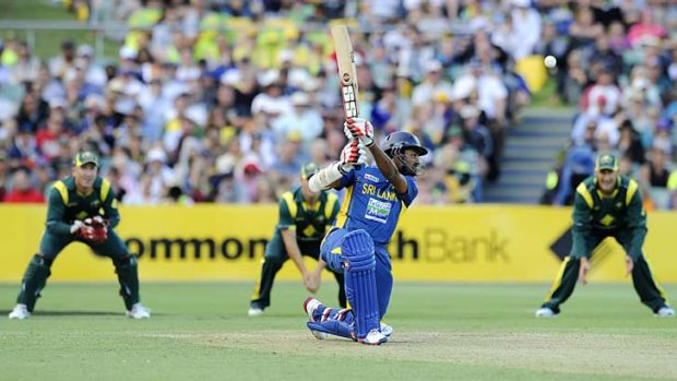 Take that: Sri Lanka's Lahiru Thirimanne hits out on his way to a century on Sunday night.