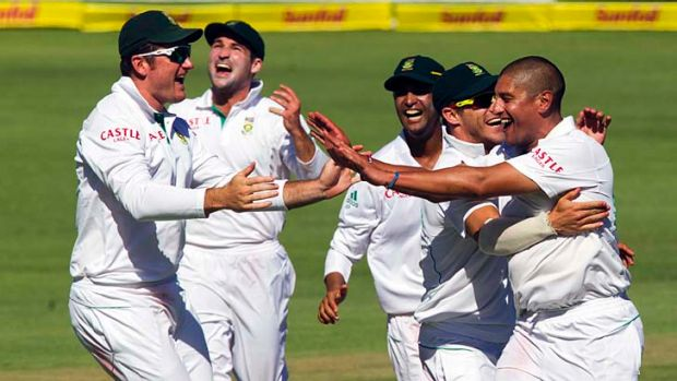 South Africa's Graeme Smith, Dean Elgar, Robin Petersen, Faf du Plessis and Rory Kleinveldt celebrate a wicket.
