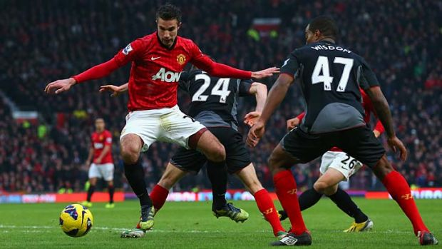 Robin van Persie takes on Andre Wisdom.