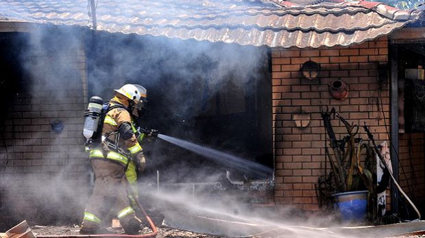 Firefighters attend a Sunshine Coast house fire.