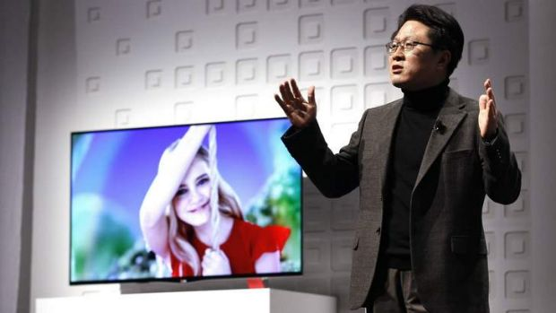 Skott Ahn, chief technology officer of LG, in front of one of the company's new OLED TVs.