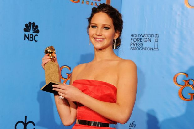 Jennifer Lawrence with her Golden Globe for Best Performance by an Actress in a Motion Picture (Musical or Comedy) for ...
