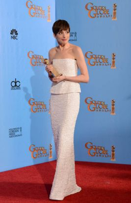 Anne Hathaway poses in the press room with her Best Performance by an actress in a supporting role motion picture award ...