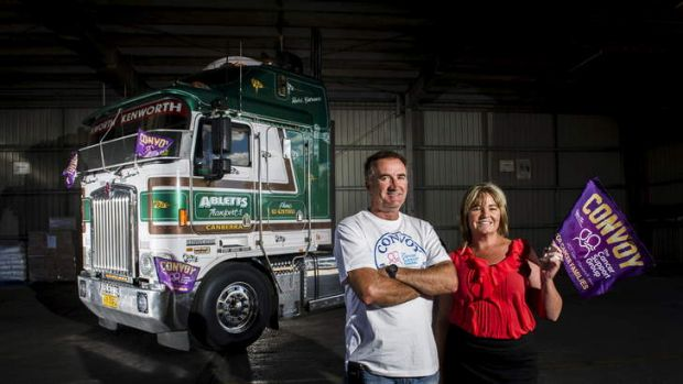 FOUR-WHEEL DRIVE: Convoy organisers Robert ''Cowboy'' Gorman and Melissa Gardiner at Abletts Transport in Queanbeyan.