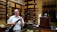 Lawrance Ordnance shop on george st, CBD. Simon Lawrence with one of his favourite guns, a Russian WW2 gun. Photo: ...