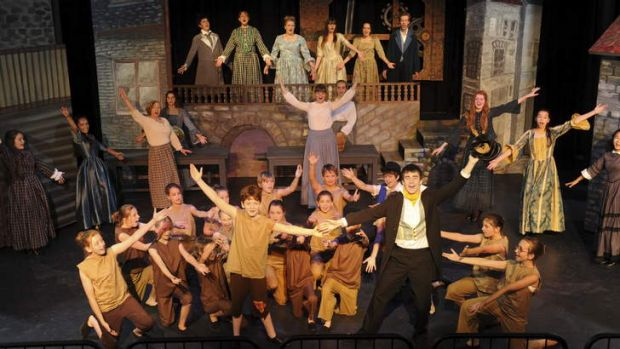 Cast members including Oliver Twist (Ben Burgess), centre left, and The Artfull Dodger (Jack Taylor), centre right, ...