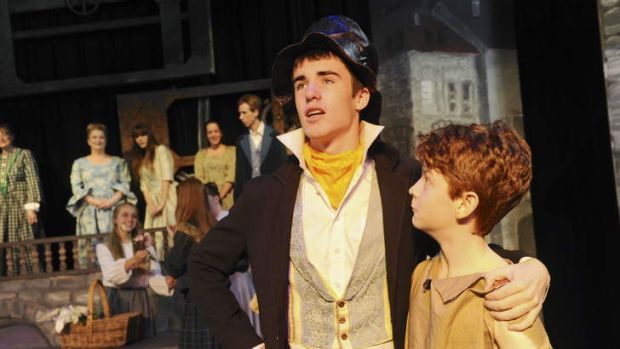 The Artful Dodger (Jack Taylor) and Oliver Twist (Ben Burgess) right,  during a scene.