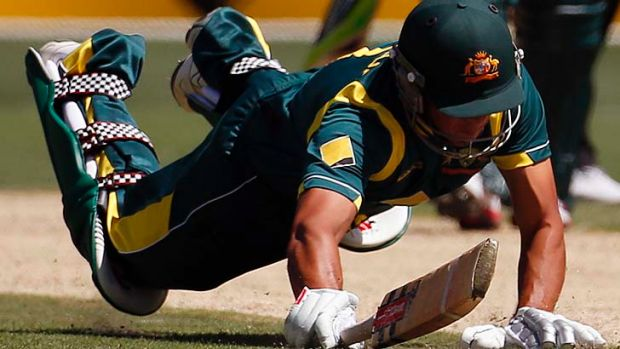 Costly runout: Usman Khawaja fails to ground his bat and is run out for three during the first one-day international ...