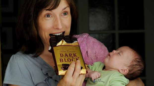 Karen Costello with her 11-week-old daughter Claire Connor enjoys some dark chocolate.