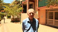 Owner occupier Sid Hickman in the common courtyard of the unit block he owns in Surry Hills. Residents are concerned ...