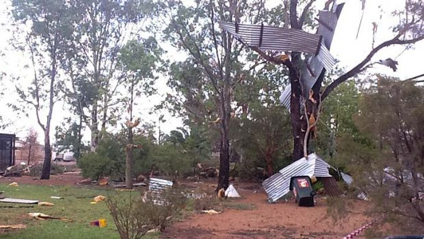 The storm tore corrugated iron from roofs at Jundah School and tossed it into trees.
