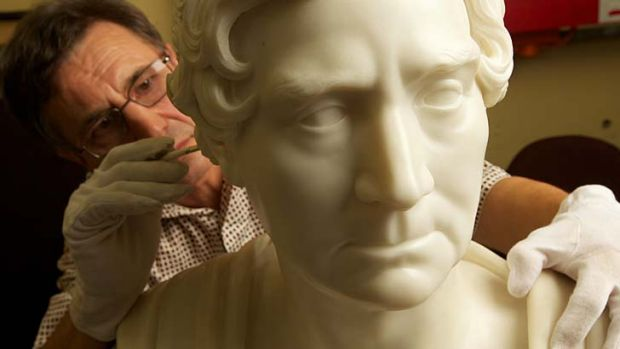 Restored ... a conservator works on a bust of William Wentworth, who 200 years ago found a way across the Blue Mountains.