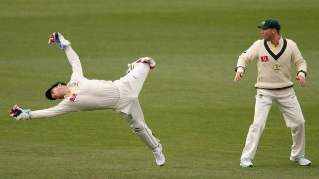 Full stretch ... Matt Wade dives for the ball during day four of the first Test between Australia and Sri Lanka.