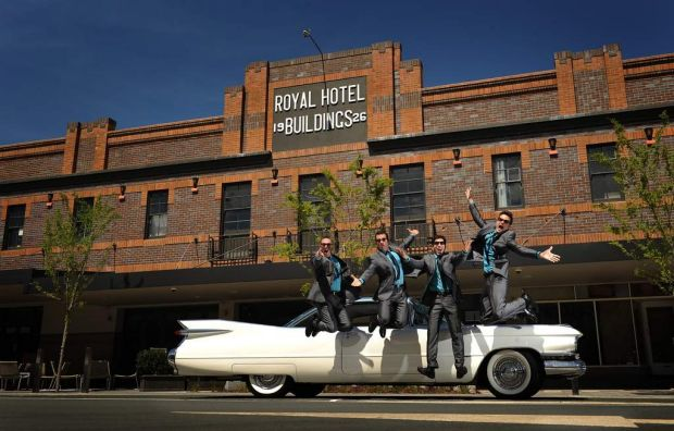 The cast from Oh What A Night outside the Royal Hotel Queanbeyan.