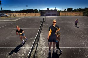 Virginia Wallace with her daughter Stella, 4, on the rundown tennis court at Cororooke, near Colac.