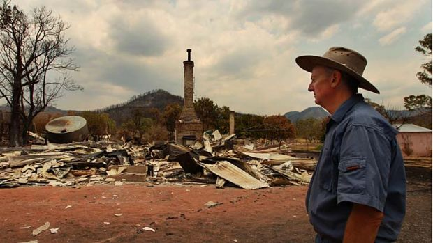 ''Nothing that man makes lasts forever'' ... Vincent Morrissey surveys the damage in front of what used to be his home ...