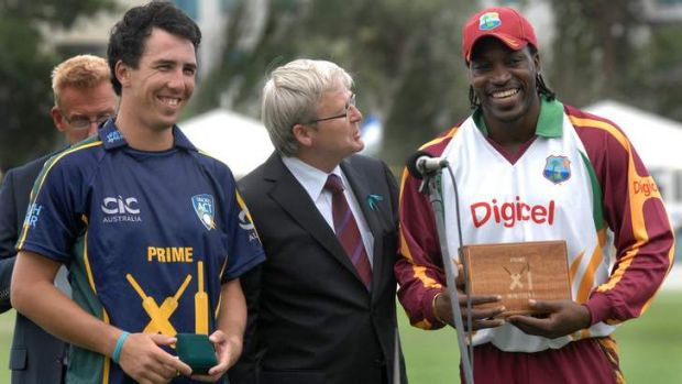 Joint Man of the Match award winners, Tom Cooper, left and Chris Gayle with PM Kevin Rudd in 2010.