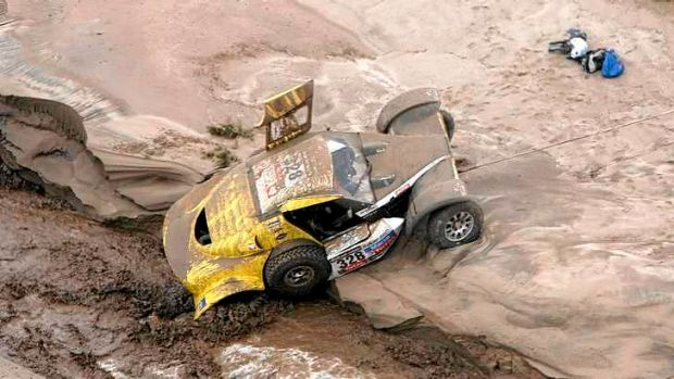 Stuck in the mud ... France's Pascal Thomasse and co-pilot Pascal Larroque are stuck  following a flash flood.
