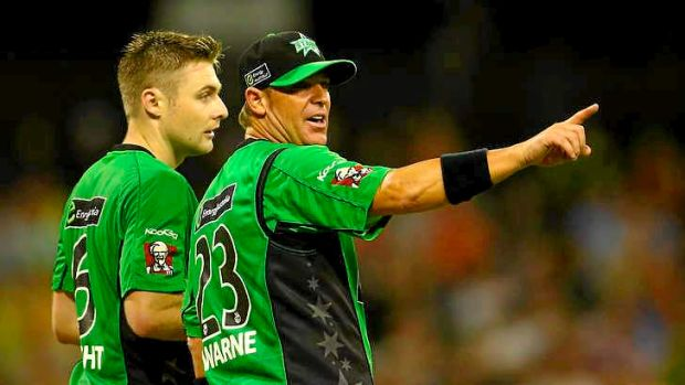 Warne helps set the field with Luke Wright.