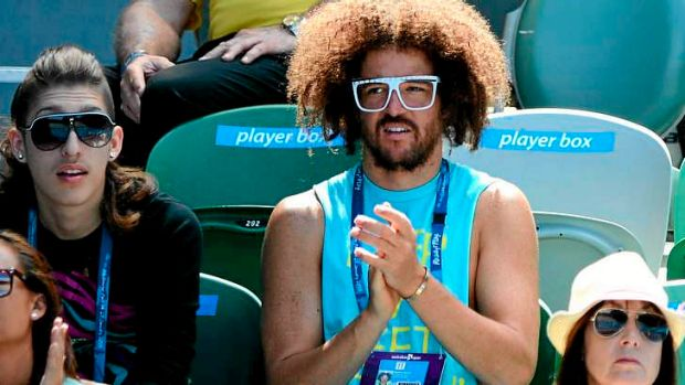 No kiss and tell ... Stefan 'Redfoo' Gordy of the American electro duo LMFAO watches Azarenka at the Australian Open.