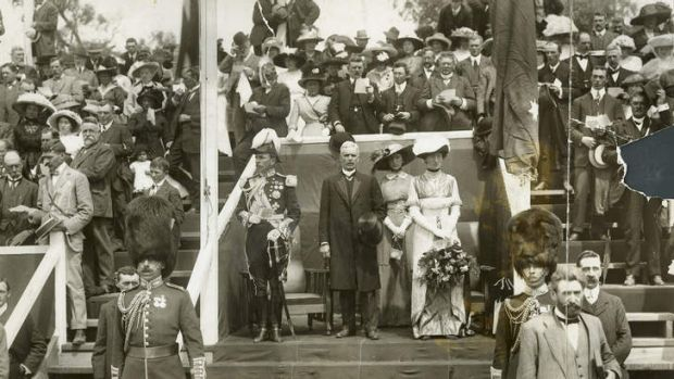 LAYING THE FOUNDATIONS:  Lord Denman in uniform, and Andrew Fisher, centre,  addressing the assembled  crowd in Canberra ...